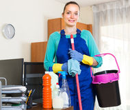 Woman cleaning at the office Stock Images