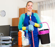 Woman cleaning office room Royalty Free Stock Photography