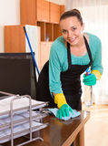 Woman cleaning office room Royalty Free Stock Image