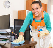Woman cleaning office room Stock Image