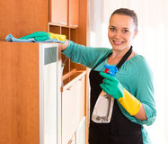 Woman cleaning office room Royalty Free Stock Images