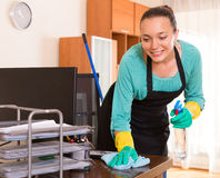 Woman cleaning office room Stock Photos