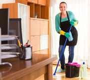 Woman cleaning office room Royalty Free Stock Photos
