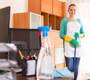 Woman cleaning at the office Stock Photos