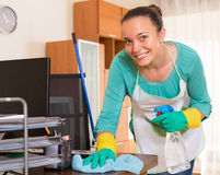 Woman cleaning at the office Royalty Free Stock Photography