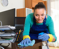 Woman cleaning at the office Royalty Free Stock Images