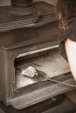 Cleaning the Wood Stove Stock Photo