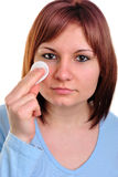 woman with cleaning pad to clean skin Royalty Free Stock Image