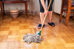 Woman cleaning parquet Stock Image