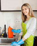 Woman cleaning pipe with detergent Royalty Free Stock Images