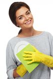 Woman cleaning plate Royalty Free Stock Images