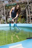 Woman Cleaning a Pool royalty free stock photos