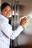 Woman Cleaning Refrigerator Stock Photo