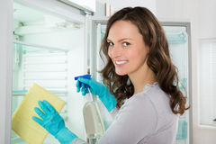 Woman Cleaning Refrigerator Stock Photos