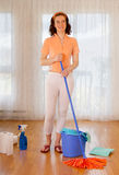 Woman cleaning the room Stock Images