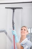 Woman Cleaning With Rubber Window Cleaner Royalty Free Stock Photos