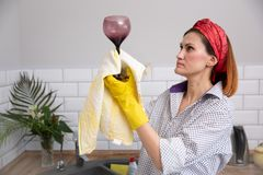 Woman cleaning or ruges glass in the kitchen stock images