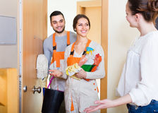 Woman and cleaning service workers stock photo