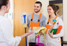 Woman and cleaning service workers Royalty Free Stock Photography