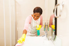 Woman cleaning sink Stock Photography
