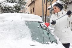 Woman cleaning snow Stock Photo