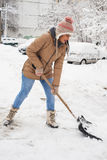 Woman cleaning snow  in parking Royalty Free Stock Photos