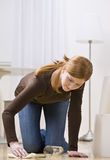 Woman Cleaning Spill Stock Photo