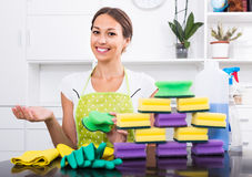 Woman with cleaning sponges. Glad woman holding cleaning sponge in hands at home indoors Royalty Free Stock Photo