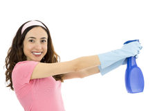 Woman cleaning with spray bottle Royalty Free Stock Images