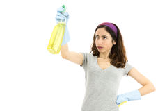 Woman cleaning with a spray detergent Royalty Free Stock Photography