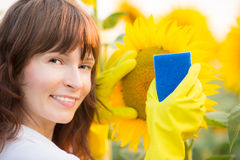 Woman cleaning sunflower Royalty Free Stock Photo