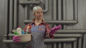 Woman with cleaning supplies gesturing happily stock footage