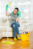 Woman with cleaning supplies in the living room Royalty Free Stock Photos