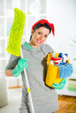 Woman with cleaning supplies in the living room Royalty Free Stock Photo