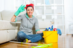 Woman with cleaning supplies in the living room Royalty Free Stock Image