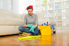 Woman with cleaning supplies Royalty Free Stock Photo