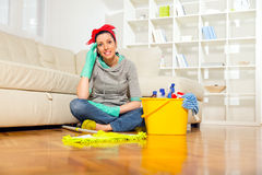 Woman with cleaning supplies Stock Image