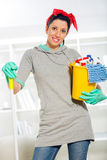 Woman with cleaning supplies Stock Images
