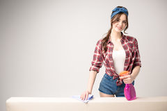 Woman cleaning surface Royalty Free Stock Image