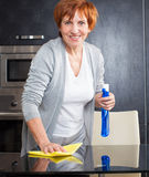 Woman cleaning table Royalty Free Stock Images