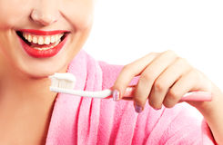 Woman cleaning teeth Stock Photo