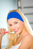 Woman cleaning teeth Royalty Free Stock Images