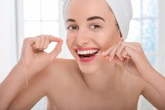 Woman cleaning teeth with floss Royalty Free Stock Photos