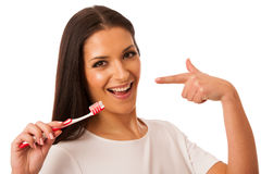 Woman cleaning teeth with toothbrush for perfect hygiene and hea Royalty Free Stock Photos