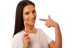 Woman cleaning teeth with toothbrush for perfect hygiene and hea Stock Images