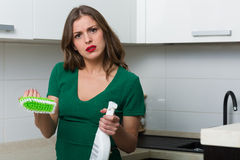 Woman cleaning up her kitchen Royalty Free Stock Photos