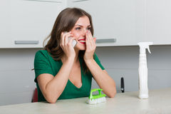 Woman cleaning up her kitchen Stock Photos
