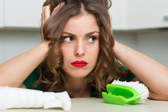 Woman cleaning up her kitchen Royalty Free Stock Images