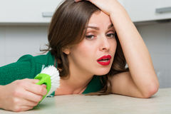 Woman cleaning up her kitchen Stock Image
