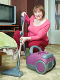 Woman cleaning with vacuum cleaner Stock Images